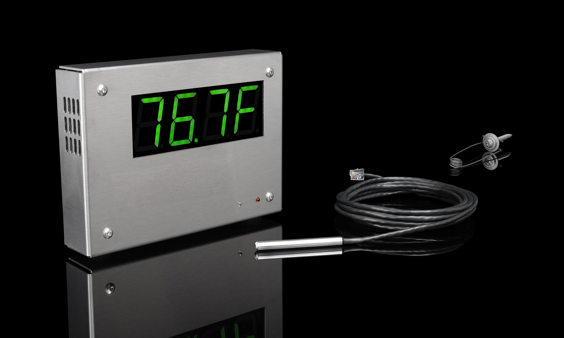 Indoor/outdoor thermometer on reflective surface
